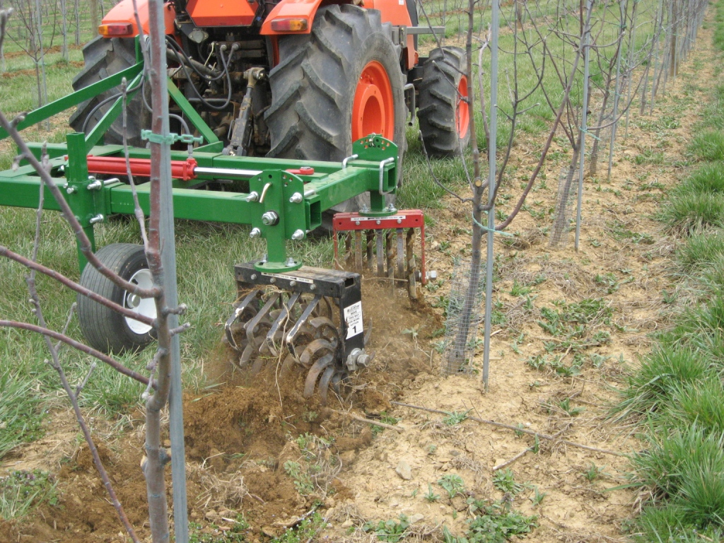 Cultivator in Orchard