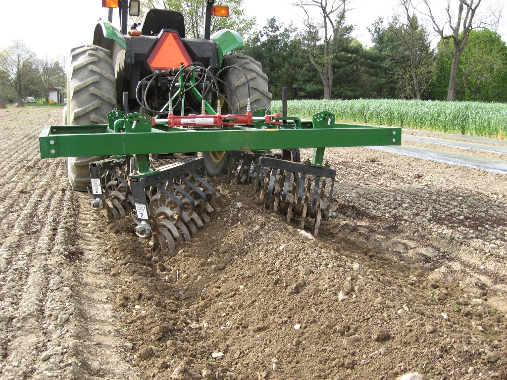 Using a cultivator to make a raised bed